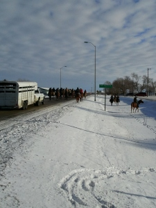 Riders enter Ft. Thompson from the dam site